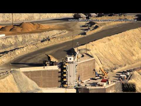 Bingham Mine Utah Large Dump Truck Hauling Copper Ore In Open Pit Mine.