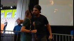 Sarah returns the bow to Stephen Amell at the Arrow panel - SDCC 2019