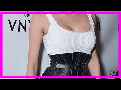 8008c9d11a Diane Kruger introduced small black belt waist corset as she poses in a  tank top and