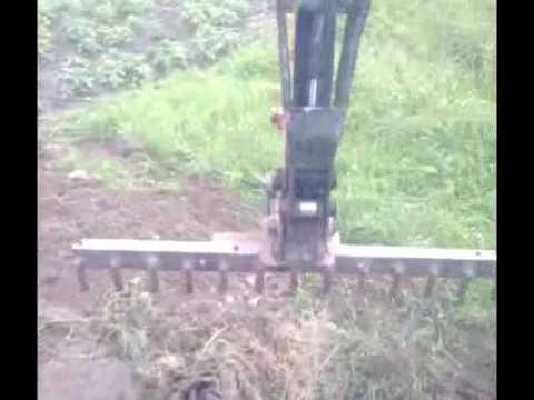 home made rake for mini digger 12610wmv  YouTube