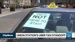 Uber-Taxi standoff at Union Station