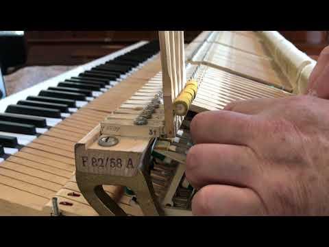 Регулировка репетиционной пружины на механике рояля