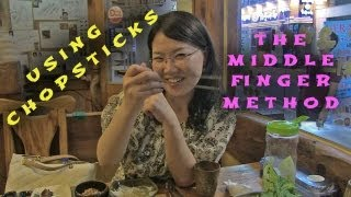 How to use Chopsticks, the middle finger method
