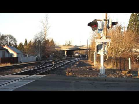 (HD) Coming and going. Amtrak 11 making a station stop in Salem Oregon