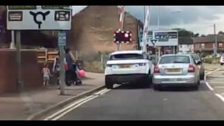 Shocking moment driver risks his life to get over Lowestoft level crossing