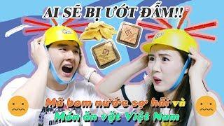 figcaption AI SẼ BỊ ƯỚT ĐẪM!! Mũ Bom Nước sợ hãi và món ăn vặt Việt Nam🇻🇳