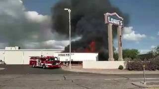 Two tractor trailers catch fire at Lowe's