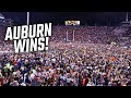 Auburn fans rush the field after beating Alabama in the Iron Bowl