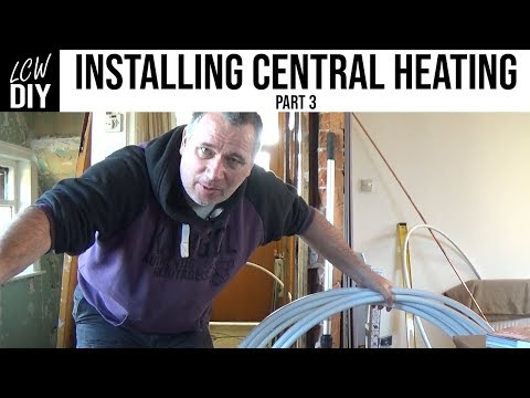 How to Install Central Heating System. part 3 - running pipes under the floorboards DIY Vlog #12