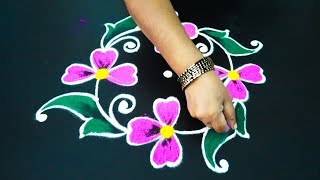 Beginneers flower rangoli designs with 7x7x1x1 dots