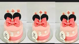 Minnie mouse theme cakebirthday cakefondant accentsHappy whiz