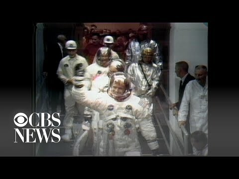 Apollo 11 astronauts wave goodbye as they head to the Saturn 5 rocket