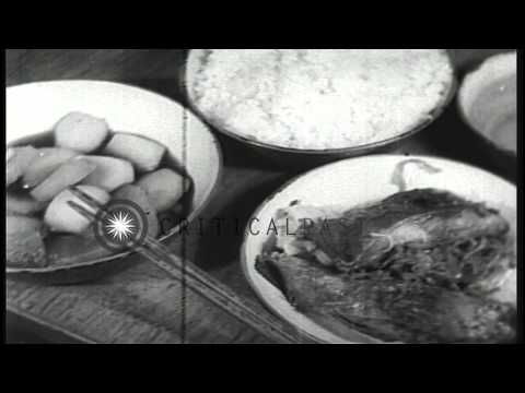 Sailors cook and eat aboard a Japanese submarine underway in the Pacific Ocean du...HD Stock Footage