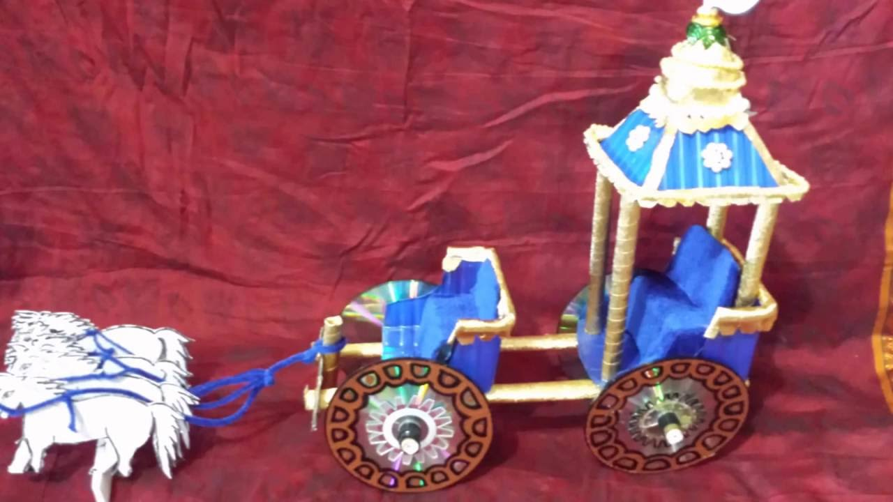 How to make a chariot from waste cd mashroom boxes youtube for Model best out of waste