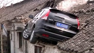 See out-of-control SUV crash onto house's roof