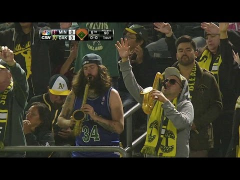 Fans sway, play saxophone to walk-up song