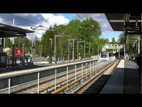 Oslo T-bane line 6 train to Bekkestua calling at Ringstabekk station.