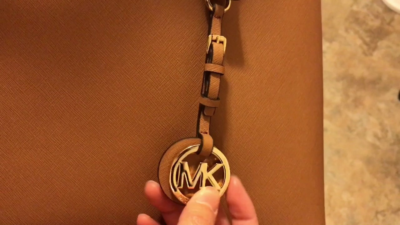 Michael Kors Jet Set Travel Tote in the Color Acorn - YouTube 0eae06c1280
