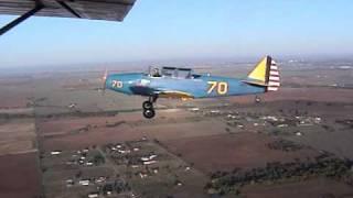 World War II Vintage PT-26 flying from a World War II training fiel...