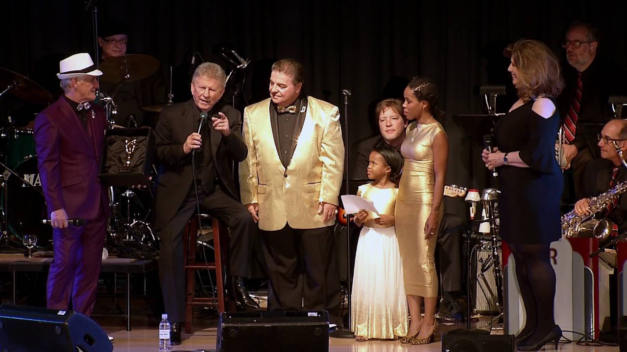 Assiah presents her Humanitarian Award to Bobby Rydell