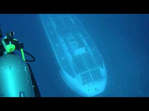 Submarine goes under diver