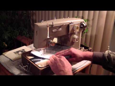 Universal Zig-Zag Deluxe sewing machine w/ manual