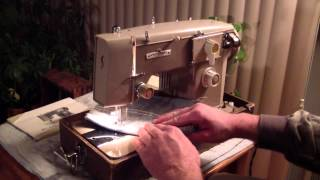 Universal Zig-Zag Deluxe sewing machine w/ manual