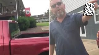'This is Nazi America': Woman confronts man flying swastika flag   New York Post