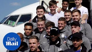 Smiley faces as England World Cup team land back into the UK - Daily Mail