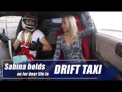 Sabina Holds On For Dear Life In Drift Taxi