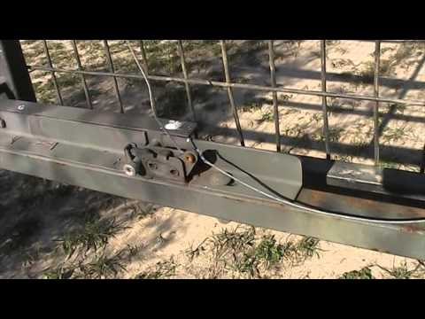 Latches And Activator For Hog Trap 1