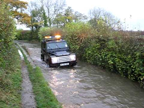 Landrover Defender 90 SVX Crossing the Ford