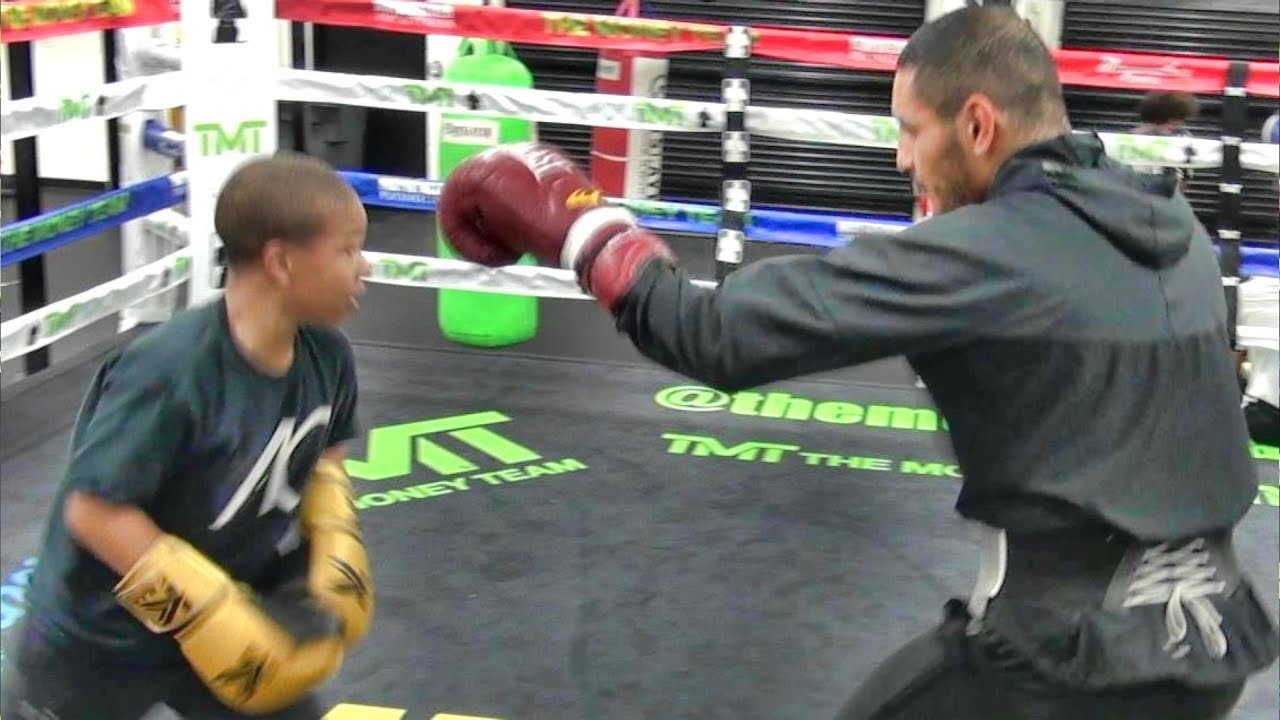 12 year old pint-sized 14x National champ Curmel Moton sparring undefeated TMT fighter Juan Heraldez