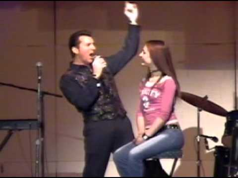 Dominic The Singer / Entertainer Serenading Young Lady On Stage