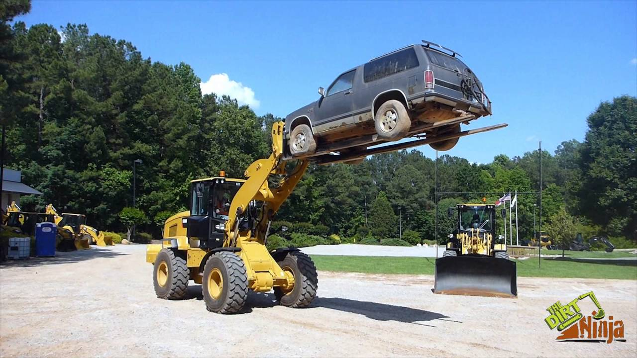 Cat 938m Wheel Loader Lifting Suv With Car Forks Youtube
