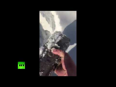 Just another day in Russia: Crew looks through snow piles for gold bars dropped from plane