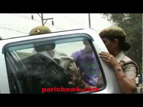 Greater Noida Police removing black film from the vehicle