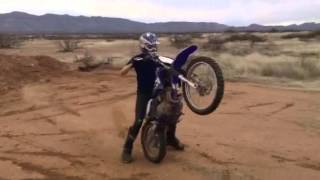 Dirt bike jumping and wheelies.