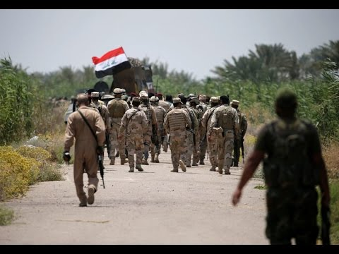 Iraqi forces fight to reclaim ISIS-held cities