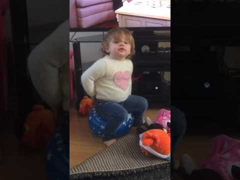 Funny bouncing baby pops balloon