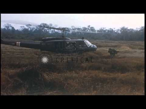 US Army 1st Infantry Division soldiers board UH-1D helicopters during their comba...HD Stock Footage
