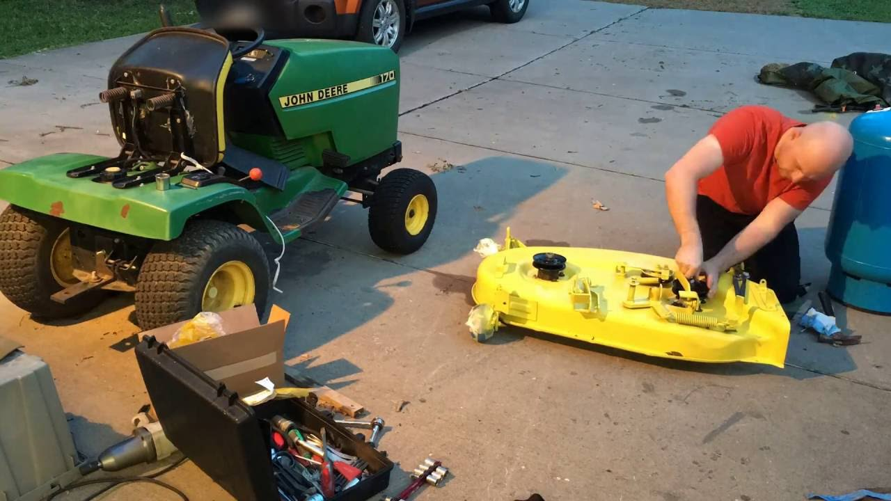 John Deere 170 Installing Mower Deck Parts - Time Lapse - YouTube