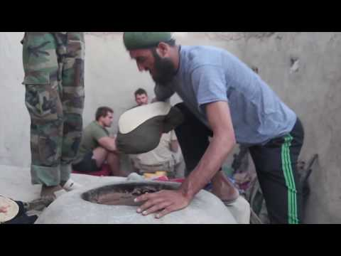 Afghan Soldiers teach US Marines how to cook Afghan food in Sangin Afghanistan 2010