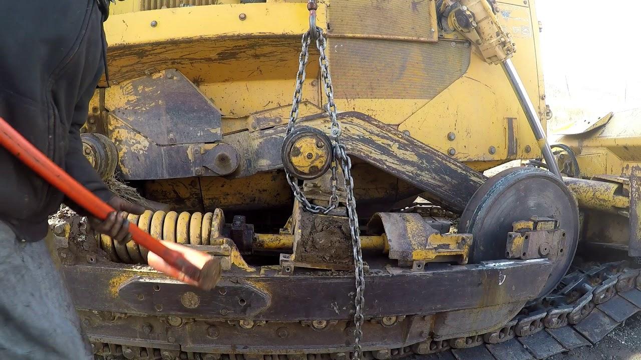 John Deere 750b track tensioner