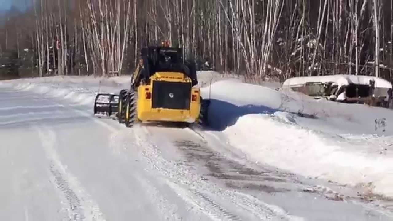New Holland L230 Skid Steer With Blade Plowing Through