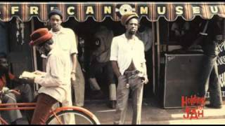 Holding on to Jah: Don Carlos blesses Gregory Isaacs