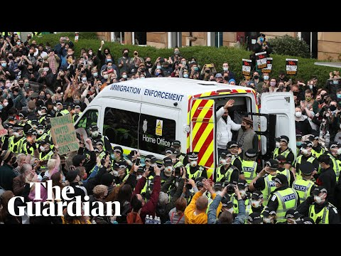 Glasgow protesters celebrate as men released from immigration van