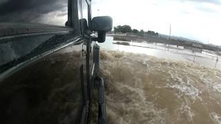 H1 driving through flood waters