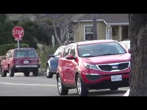 What a coincidence!  A RED SUV stops in the middle of the road. - 5/7/2014