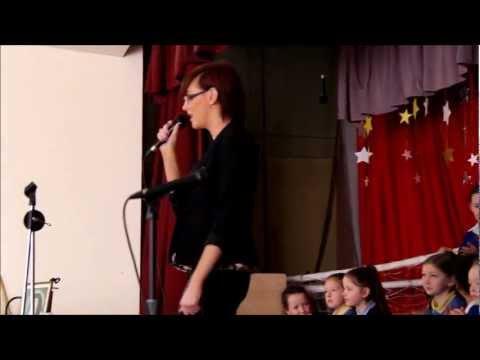 Sinead O'Brien sings for her young fans in St Louise School Ballyfermot